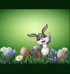happy easter bunny with decorated easter eggs in a vector image
