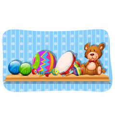 balls and other toys on the shelf vector image