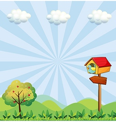 A birdhouse at the hilltop with an arrowboard vector image vector image