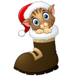 Christmas kitten in santa boots vector