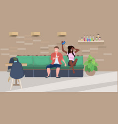mix race couple sitting on couch man woman using vector image
