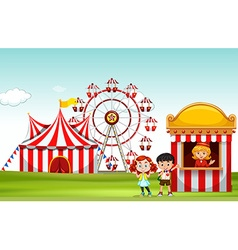 Children buying ticket at the fun park vector image