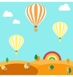 Balloons flying over the autumn landscape vector image