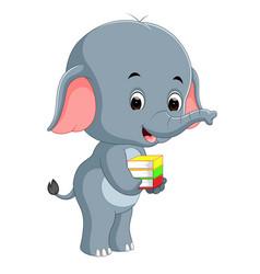 Cute elephant holding book vector