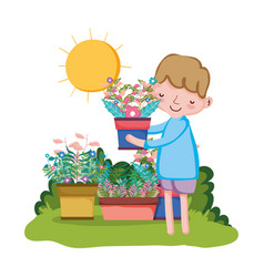 little boy lifting houseplant in the garden vector image