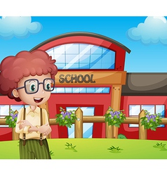 A boy with a school building at his back vector image vector image