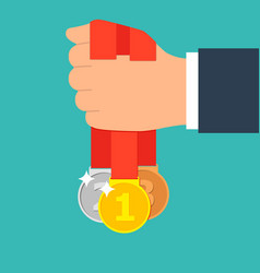 set of medals in his hand winner and winner vector image