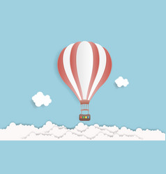 hot air balloon in the sky with clouds origami vector image