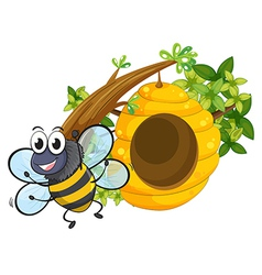 A smiling bee near the big beehive vector image