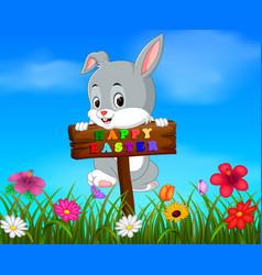 Easter bunny hanging up blank wood in garden vector