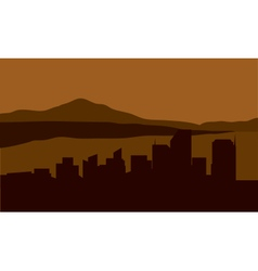 Silhouette of city with mouantain background vector