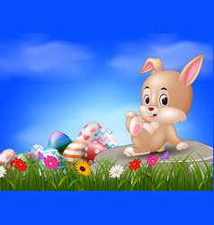 easter bunny and eggs sitting on the stone vector image