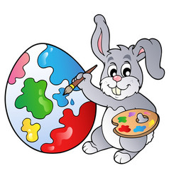 bunny artist painting easter egg vector image