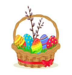 colorful eggs brench of willow in wicker basket vector image