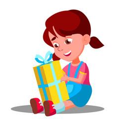 little girl opening gift christmas box vector image