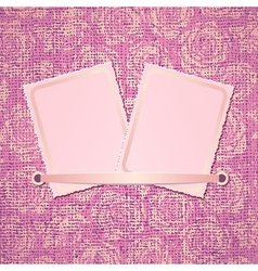 Two photo card on pink fabric background vector image