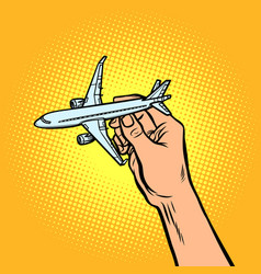 passenger plane in hand metaphor of travel and vector image