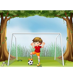 A little soccer player in his red uniform vector image vector image