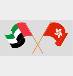Crossed and waving flags hong kong vector