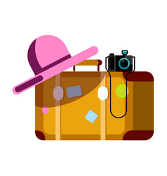 suitcase with pink hat and photo camera isolated vector image