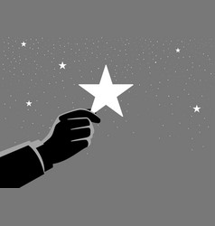 businessman hand picking up a star vector image