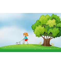 A girl walking with her dog at the hilltop vector image vector image