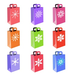 shopping bags with snowflake symbols vector image