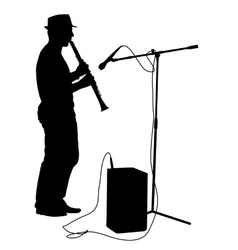 Silhouette musician plays the clarinet vector image vector image