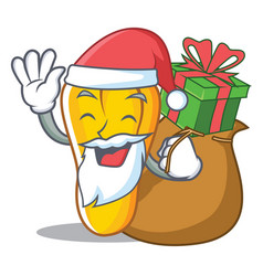 Santa with gift cashew mascot cartoon style vector