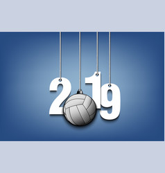 2019 new year and volleyball hanging on strings vector