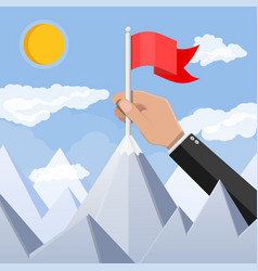 Businessman hand puts flag on peak mountain vector