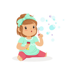 adorable little girl sitting blowing bubbles vector image