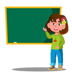 Schoolgirl standing near a school board in the vector