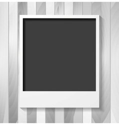 Grey blank Polaroid photo frame on wood vector image