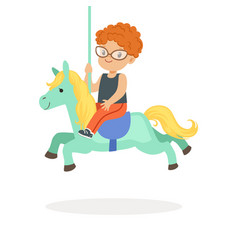 cute little redhead boy riding on the carousel vector image