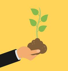 Hand holding seedling flat design vector