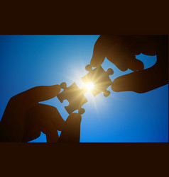 hands hold a puzzle on a sunny background vector image