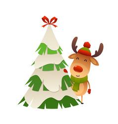 Cute cartoon reindeer behind christmas tree vector