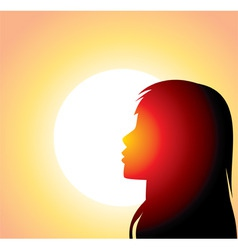 Sillouette of woman in front of sun vector