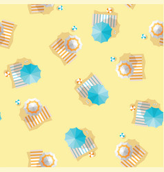 Beach umbrellas striped towels and ball top view vector