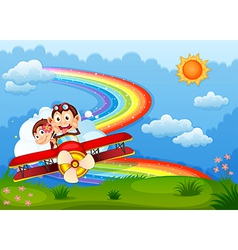 A plane with two boastful monkeys and a rainbow in vector image vector image