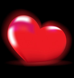 Luminous red heart on a black background vector