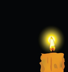 burned candle on black background vector image