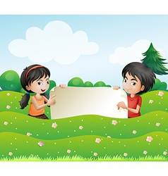 A boy and a girl holding an empty cardboard vector image