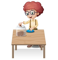 A boy putting chips in the jar vector image vector image