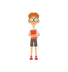 Cartoon nerd schoolboy standing with book in hand vector