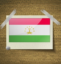 Flags Tajikistanat frame on a brick background vector image vector image