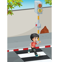 A boy running while crossing the street vector