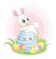 white bunny character lying on a big easter egg vector image