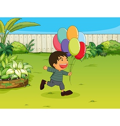 A smiling boy with balloons vector image